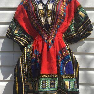 African print top. 100% cotton, peplum design.